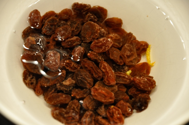 Soak raisins for 30 minutes in aqua vit (or aka vit)