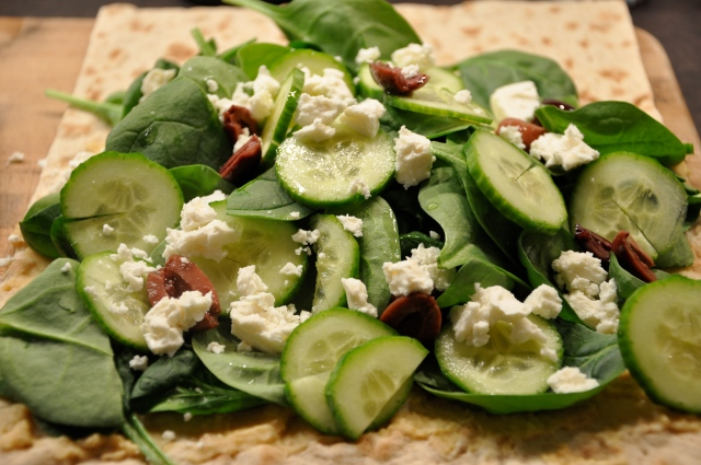 Lavash Bread with hummus, spinach, kalamata olives, feta, and cucumber
