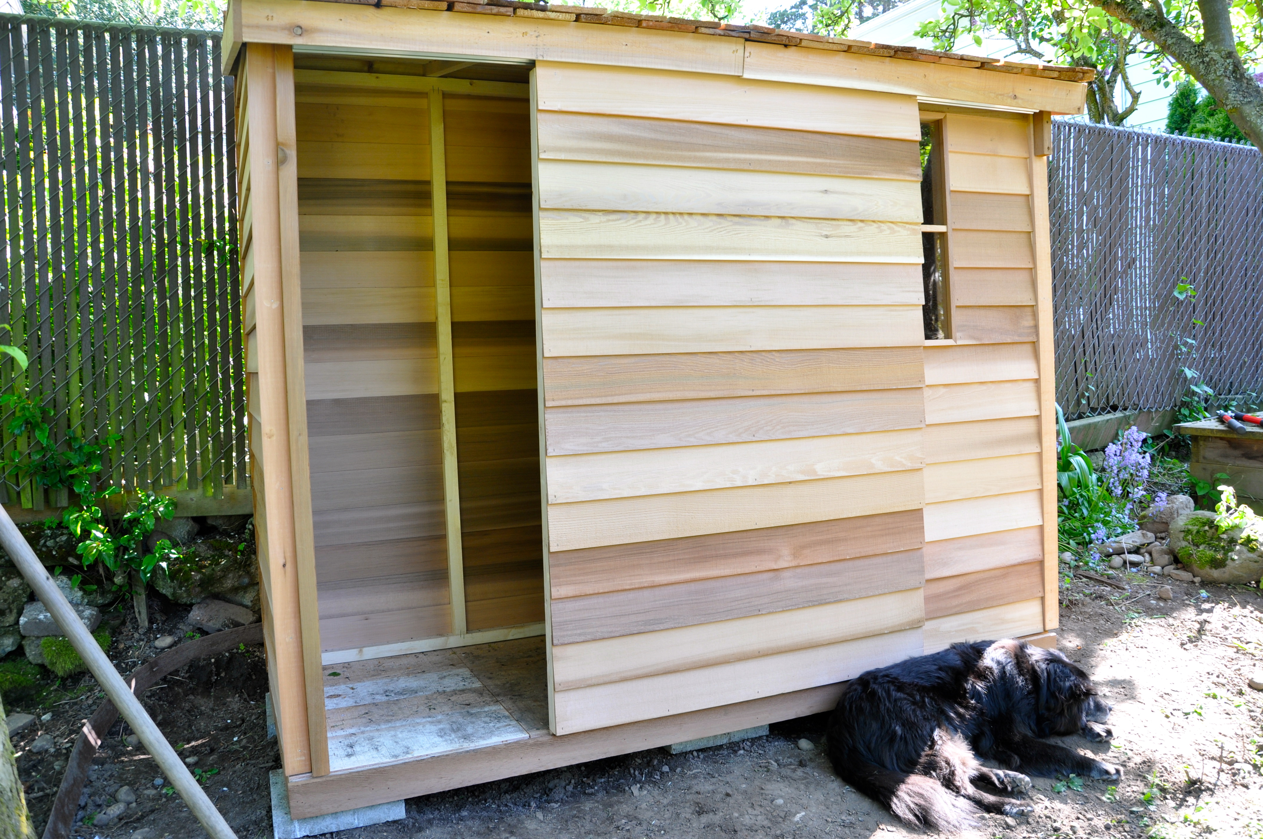 A traditional shed shape it is made from slats of wood that allow light and ventilation to flow through its walls. As storage and compact work are often ... & Garden shed sliding doors