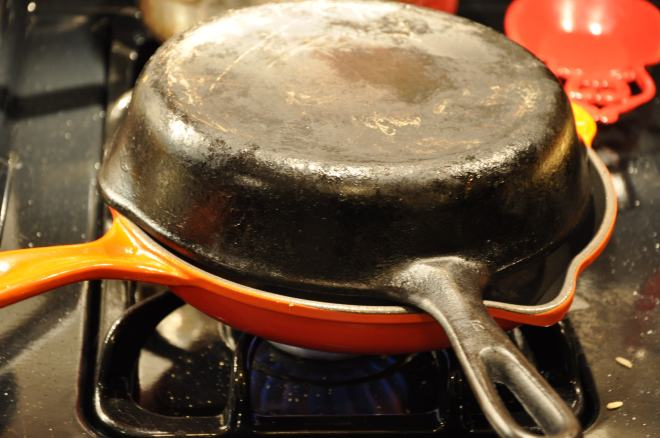 Invert a second frying pan